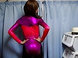 Crossdresser In Pink Metallic Leotard